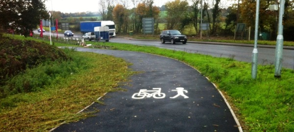 Cyclepath following haphazard strimming of overgrowing weeds